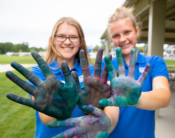 staff with painted hands