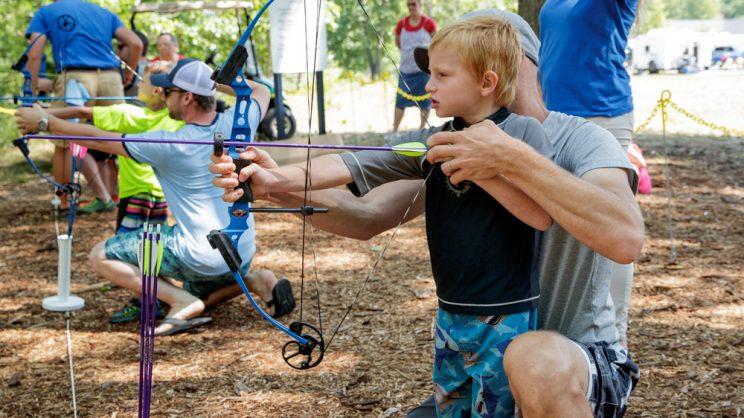 dad and son shooting arrows