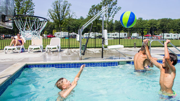 boys playing water basketball