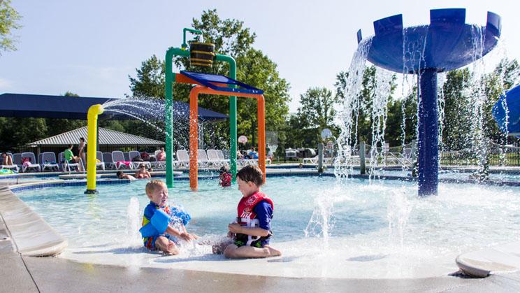 kids playing at pool's edge