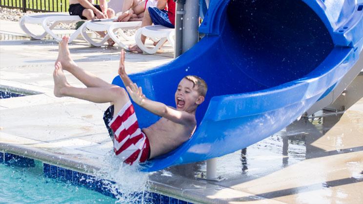 boy coming down waterslide